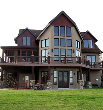 Custom built home by Shircliff Construction featuring a wrap around deck and floor to ceiling windows